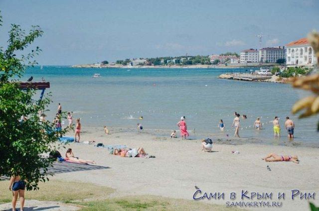 Городсокй пляж в Омеге